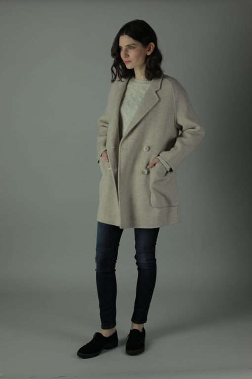 Casually luxurious is our oversized Ellen double-face Cashmere Coat. Thigh length for casual wear, this coat features 100% Cashmere, loose fitting style and beautiful marble effect buttons. Front View.