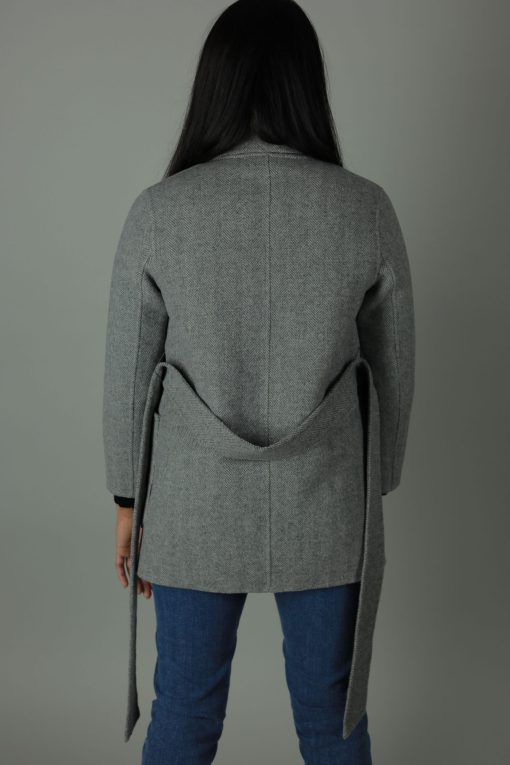 Luxurious style in The Lucinda Cashmere double-face Coat for a year round look. Thigh length for casual wear, this coat features 100% Cashmere, loose fitting wrap around style and waist belt for silhouette.