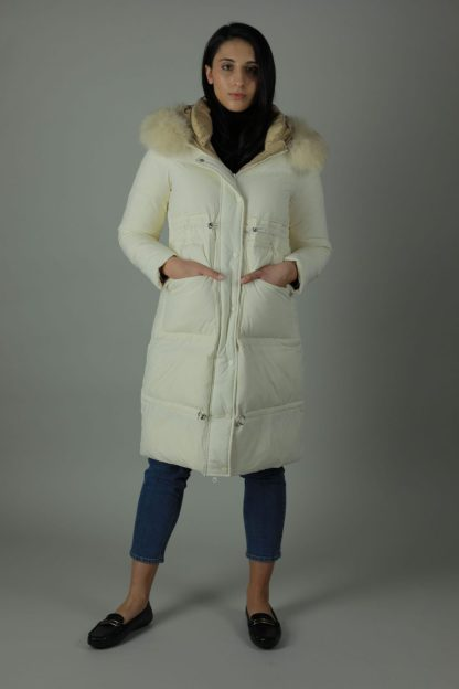 The Charlie Down Coat is perfect for the cooling weather. The Charlie is a high shine beautiful Down filled Nylon coat which features an ample hood and a detachable fur trim for style. The Charlie has a rich white exterior, deep cream contrasting interior, white and silver buttons and zip, two front exterior patch pockets and a interior breast pocket. Front view.