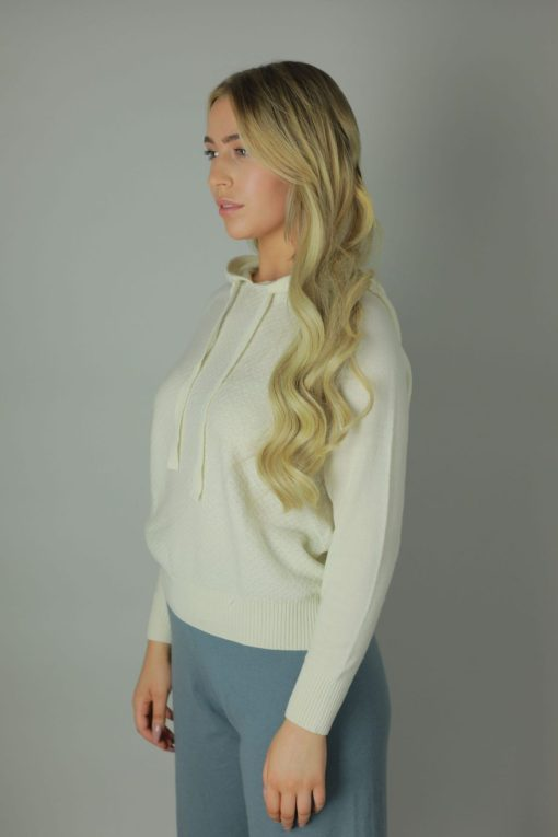 The 100% cashmere hoodies are the luxurious feel you need against your skin. Designed with comfort in mind our cashmere Hoodies are rich in room, comfort, quality and colour. compliments any outfit, both light and roomy it will cool you in the summer months and leave you feeling cozy in the winter. Side view.