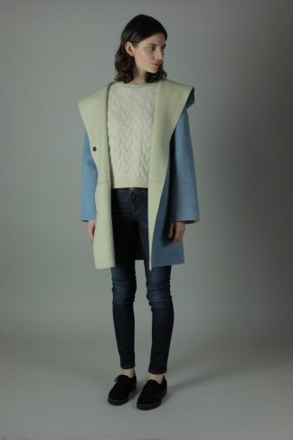 Luxury in The Cassie Cashmere Coat. Thigh length for all round wear, this coat features 100% soft Cashmere, loose fitting style, two front patch pockets and beautiful white soft cashmere interior for inside out look. Front view.