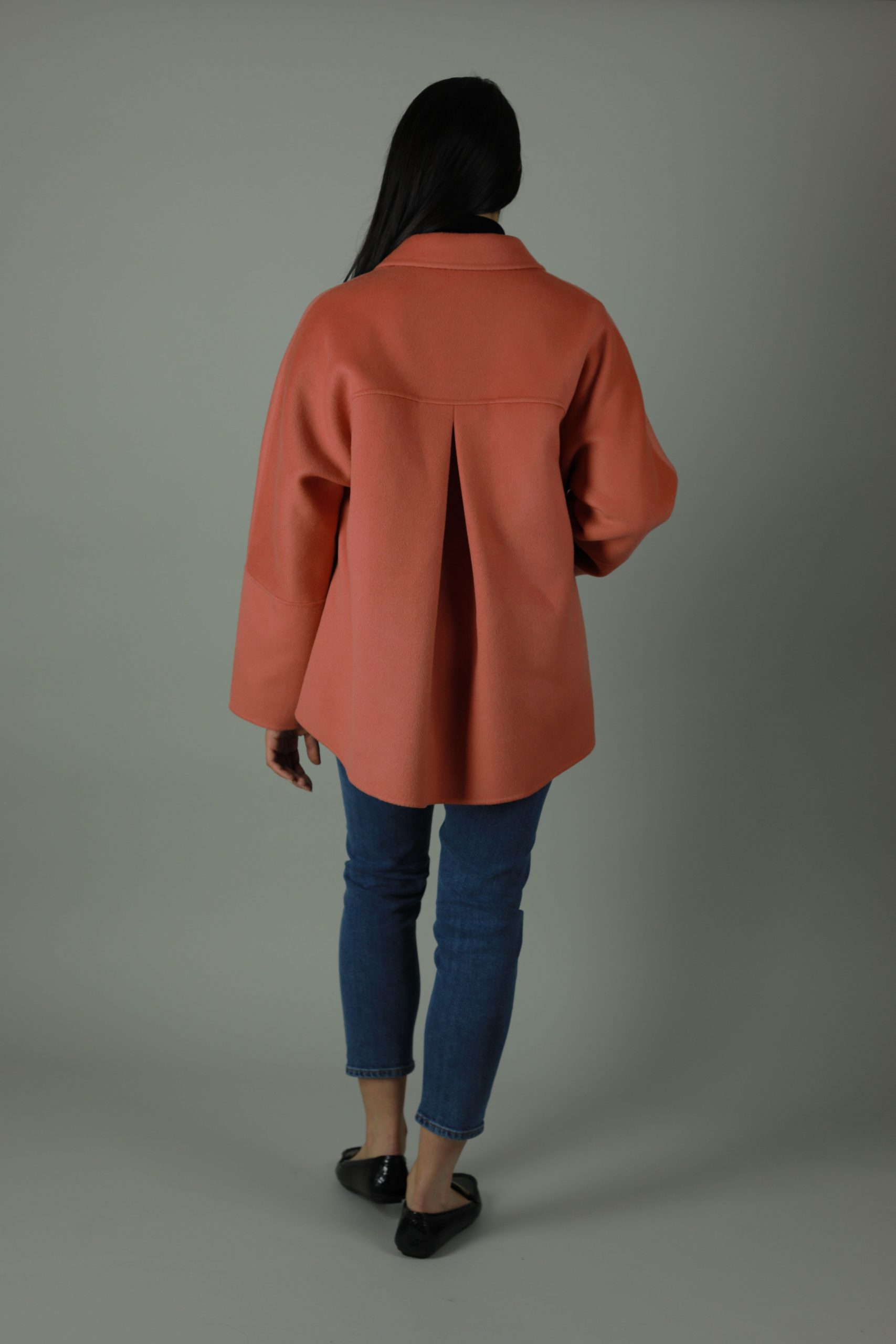 Luxurious style in The Clare Cashmere Coat for a year round look. Thigh length for casual wear, this coat features 100% Cashmere and loose fitting style for comfort and warmth.