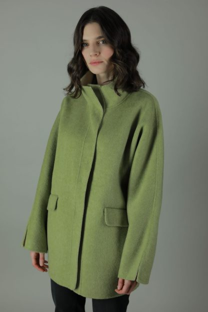 Luxury in The Chloe Cashmere Coat. Thigh length for all round wear, this coat features 100% soft Cashmere, loose fitting style, two front patch pockets and beautiful white soft cashmere interior for inside out look. Front view.