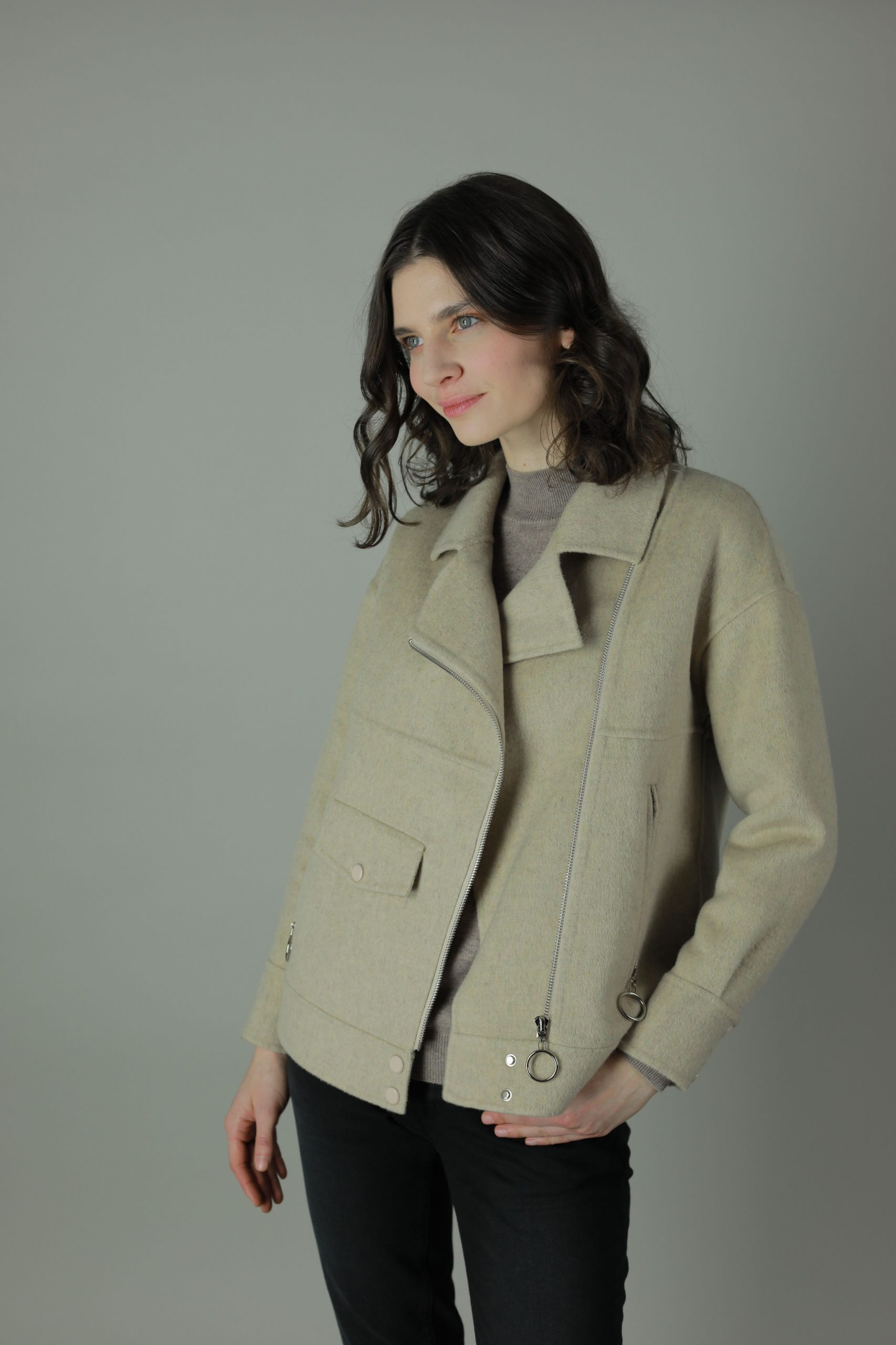 The Roxanne classic biker style jacket features 100% double-face Cashmere for luxury, style and some rock n roll. This jacket comes in cream and blue with silver trims and soft cashmere interior for the perfect luxurious feel year round.