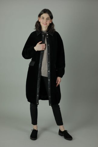 The Siana Shearling Coat will help you fight off the elements this winter. The Siana is fully lined, designed to retain heat, roomy for layering and is accessorised beautifully with two front patch pockets, interior breast pocket, silver design buttons, faux leather trims, collar and a waist belt for the perfect silhouette to go with just about anything.