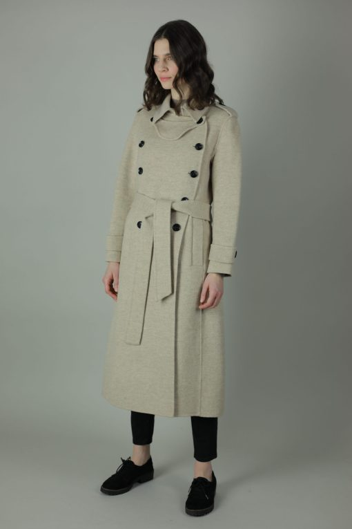 Luxury and warmth, the Alice Cashmere double wear coat is a non compromiser. Any season, any occasion this iconic style features 100% cashmere, back belt for silhouette and comes in two colours. Side view.