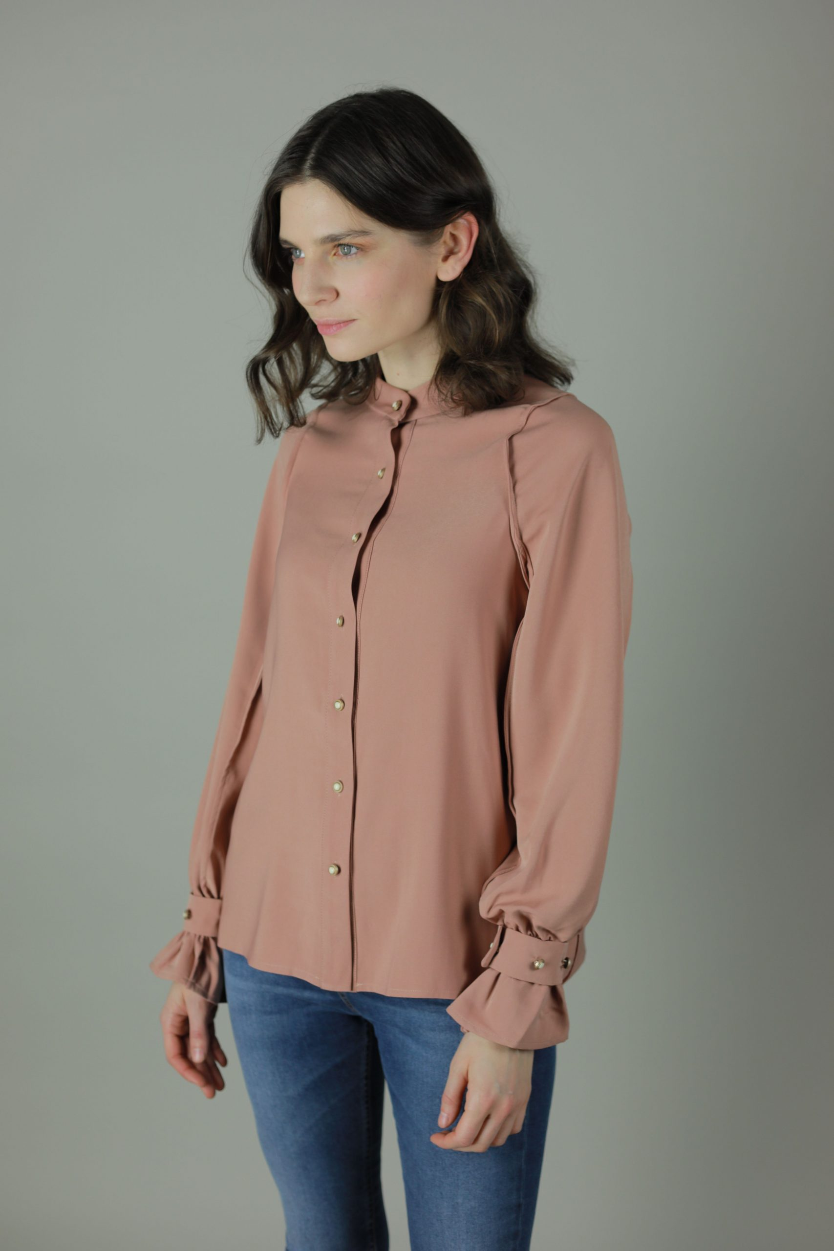 The Peach Pearl blouse is made to compliment any outfit, work, casual or formal wear. Timelessly luxurious the Peach Pearl Blouse features beautiful soft feel against your skin, hanging for flattering fit and pearl style buttons for an exquisite finish.