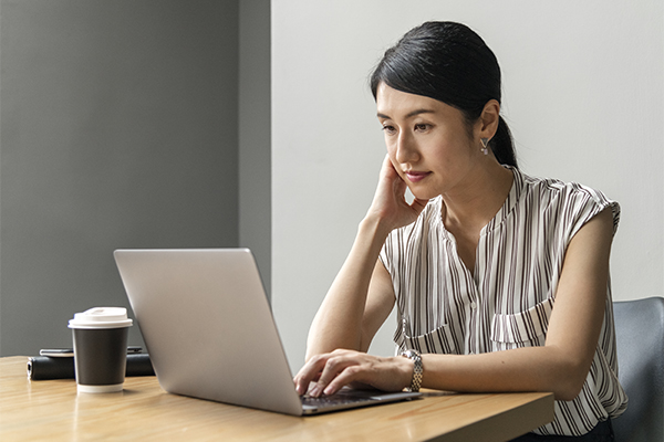 Woman looking at a laptop computer