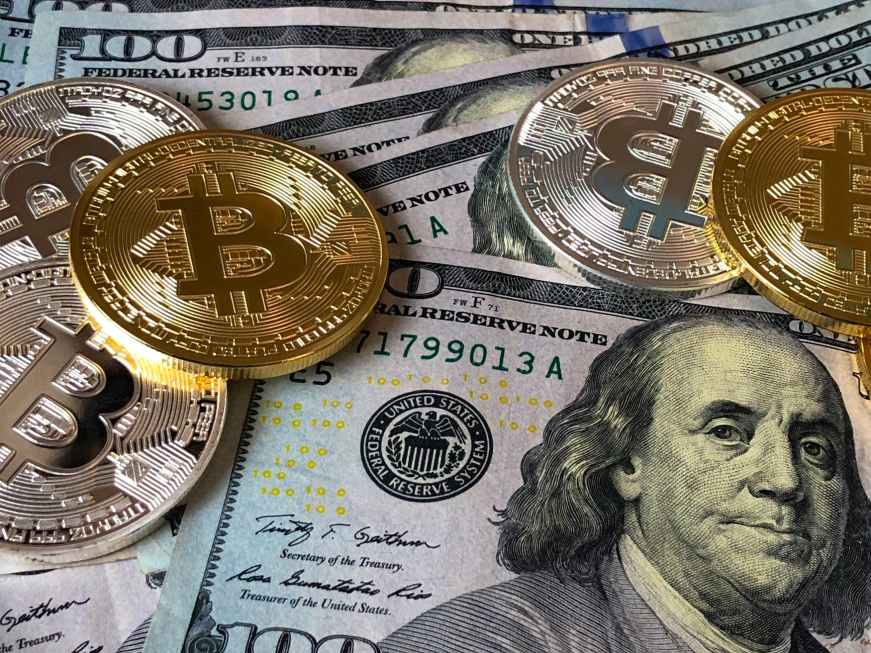 bitcoins and us dollar bills, blockchain