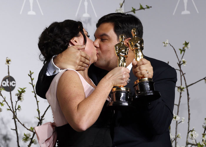 Kristen Anderson-Lopez and Robert Lopez celebrating Oscar win! Photo: indianexpress.com/photos/entertainment-gallery/oscar-2014-moments-too-sweet-to-be-missed/#kristen_lopez