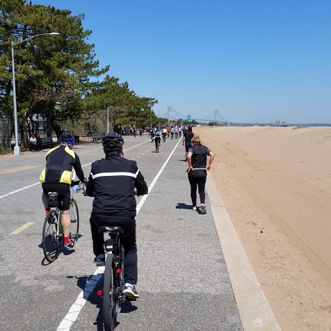 """@Mile 31: The final stretch was along an amazing red sand beach. I wanted to stop and enjoy, but overhearing someone else snapping that she """"just wanted to finish this thing!"""" kept me pedalling."""