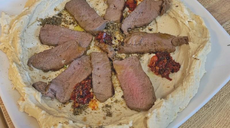 Grilled Mediterranean Antelope Steaks with Hummus and Israeli Salad