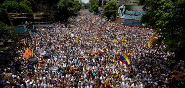 "In this Sept 1, 2016 photo, demonstrators take part in the ""taking of Caracas"" march in Caracas. Venezuela's opposition is vowing to keep up pressure on President Nicolas Maduro after flooding the streets of Caracas with demonstrators Thursday in its biggest show of force in years. Protesters filled dozens of city blocks in what was dubbed the ""taking of Caracas"" to pressure electoral authorities to allow a recall referendum against Maduro this year. (AP Photo/Ariana Cubillos)"