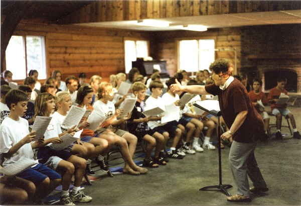Norma Preheim directs a rehearsal of the Newton Community Children?s Choir in 1997 at Camp Hawk. Courtesy photo