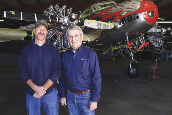 Leeb VonFange, left, and Fred Bruns, both with Wichita Air Services Inc. Warbird Division in Newton stand in front of the Lockheed 10A