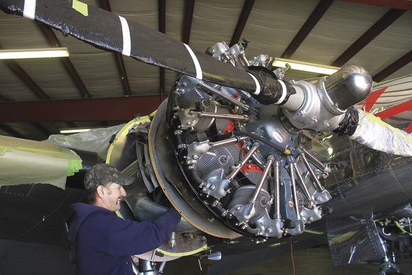 Leeb VonFange, Wichita Air Services Inc. shop manager, checks out part of the Lockheed 10A