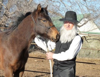 Maynard Knepp dons the garb he will use to portray a fictional Amish minister in ?Jonas, the Life and Times of an Amishman,? a one-man presentation he and wife Carol Duerksen have developed to celebrate the 20th anniversary of their first Amish-based novel, ?Runaway Baby.? Courtesy photo