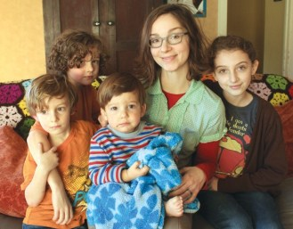 Trenna Davenport (second from right) sits on the davenport with her four children, from left, Josiah, 5; Simeon, 8; Gideon, 2; and Ruby, 11. Photo by Wendy Nugent