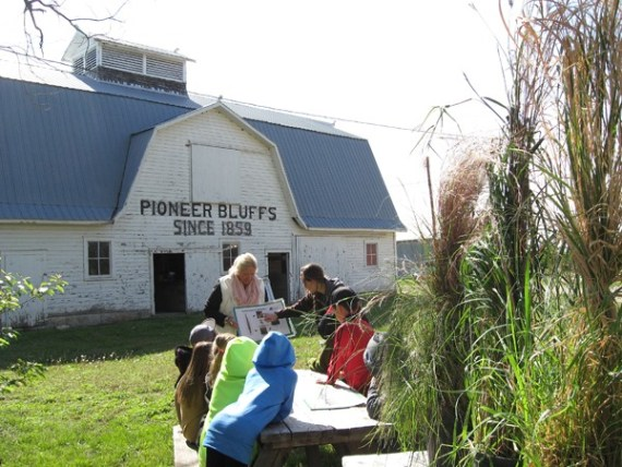 Volunteer Judith Haffner of Butler County gives a lesson to Chase County third-graders during a educational outing at Pioneer Bluffs. The historic property is open?Friday-Monday?and by appointment. Contributed photo