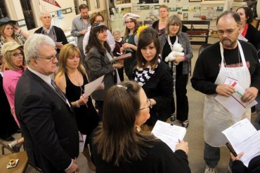 Debra Hiebert, in foreground, leads the Murder at the Manor Mystery Night, which was a murder mystery event, in February.