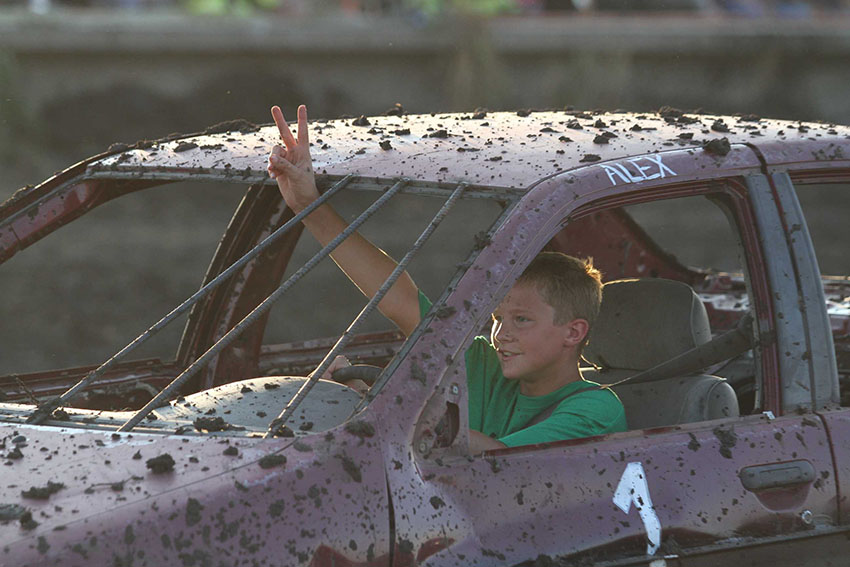 Alex Kromeier celebrates while leaving the demolition derby arena. The 14-year-old finished second in the figure eight race.