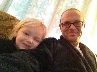 Enjoying a little Thanksgiving morning TV with my baby girl.