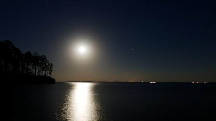 The rising moon over Sabine Forest and the Toledo Bend Reservoir.