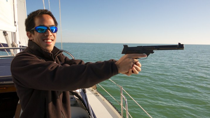 Eric fires his first handgun, a 22-caliber pistol.