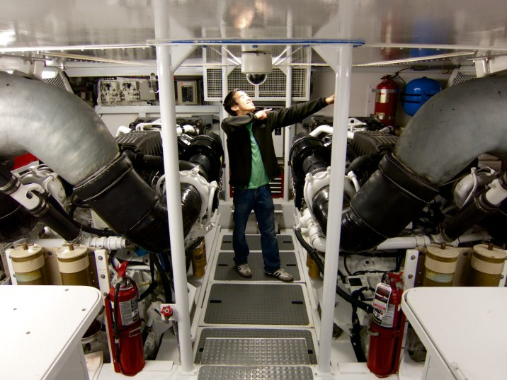 Eric in the engine room posing between 1700 horsepower of diesel awesomeness.