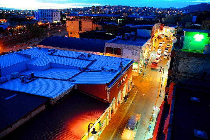 The view of the tourist district and shops from the rooftop of Hotel Acosta at sunset.