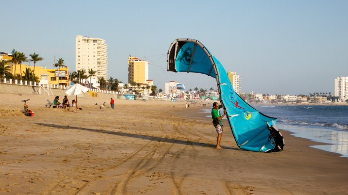But plenty of steady wind makes the day interesting for this man while he learns how kite surf.