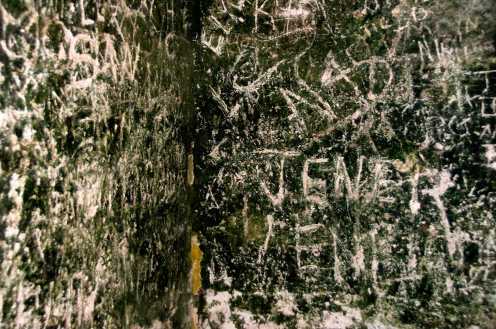 Visitors through the years have scratched things into the soft limestone walls.