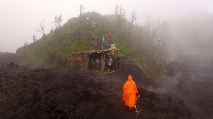 The lava shop sells jewelry made of lava rocks, and it sits at the very edge of the lava flow from a March 2014 eruption that still steams.