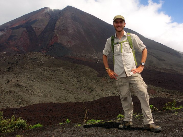 Standing in front of the latest lava flow from Volcan de Pacaya.