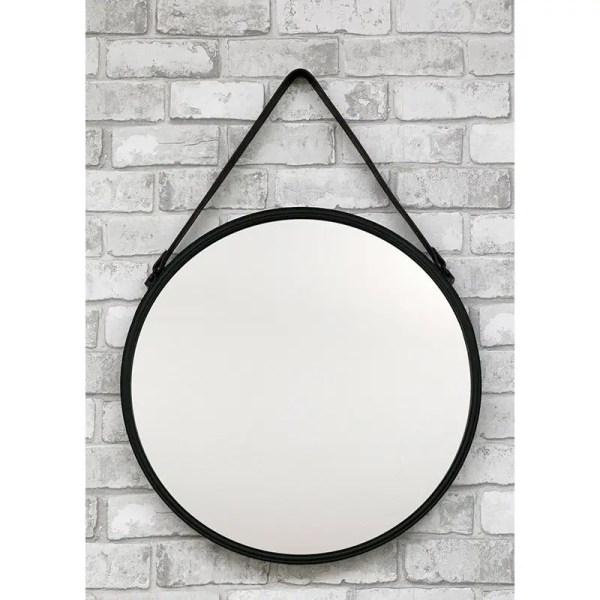 okrągłe lustro na skórzanym pasku