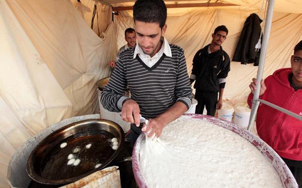 عامل حلويات سوري -(أرشيفية)