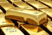 الذهب ينخفض بعدما لامس أعلى مستوى في عام
