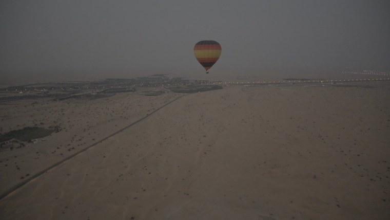 Hot air balloon with the passengers is going to land. Hot air balloon Ride in Dubai