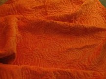 orange minky backing, quilting detail