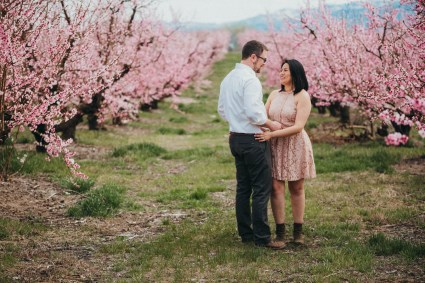 Cute couple engagement poses cherry blossoms boise engagement photographer