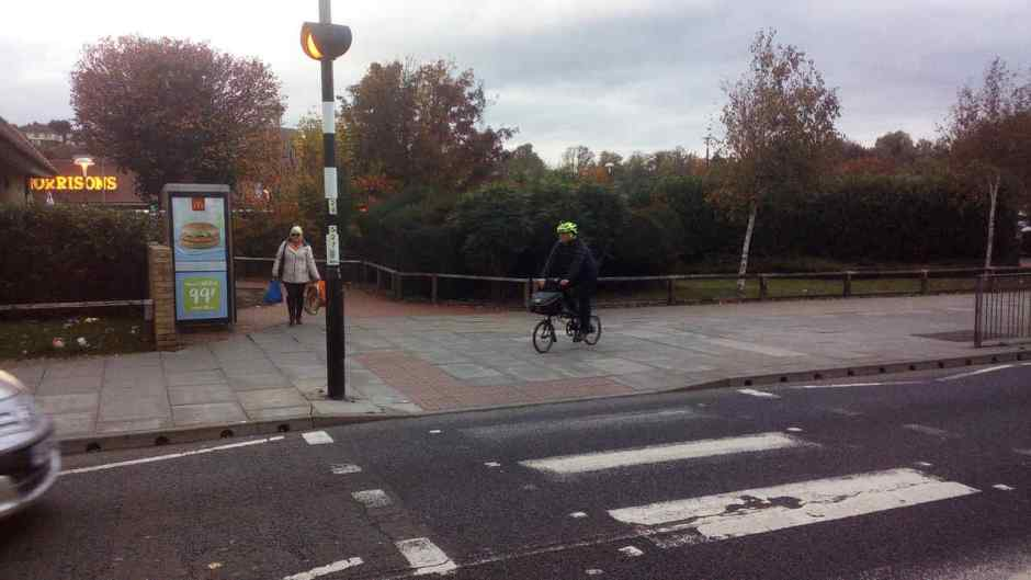 Guy on a bike by the Morrisons pedestrian crossing. Queens Road, Hastings.