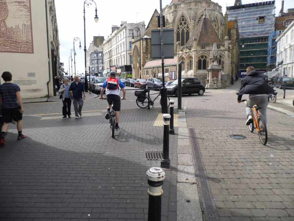Two bikes leaving Robertson Street pedestrian zone, Hastings.
