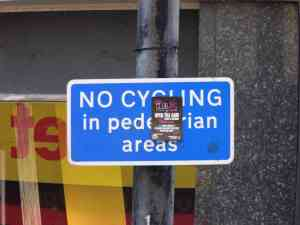 A blue no-cycling advisory sign