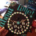 Shoot the moon graduation cap design the graduation cap board in a