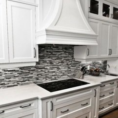 Grey Kitchen Backsplash Lights Hanging 35 Beautiful Ideas Hative Black Or Linear Glass Tile With Crisp White Cabinetry And Marble Countertops