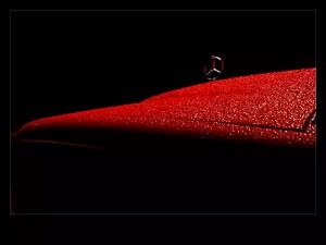 Lady in Red - red Merdes Benz under the rain in the dark