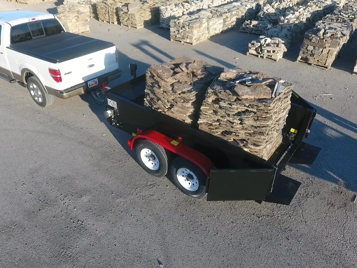 trailer loaded with pallets of pavers