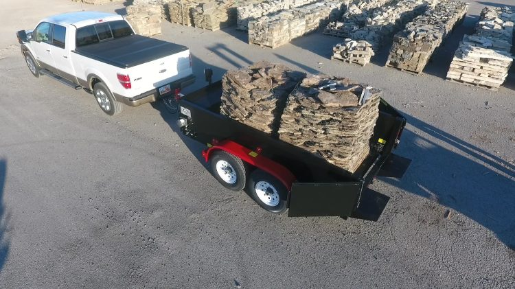 Haulit trailer loaded with pallets of pavers