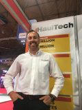 HaulTech director Craig Lamont standing and smiling with the HaulTech stand at the CV Show 2019