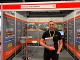 HaulTech director Craig Lamont, wearing black, stood in front of the HaulTech stand at the Tip-Ex show 2019